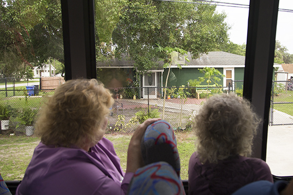 Bus tour particpants get a look at a Habitat for Humanity house built in Wimauma.