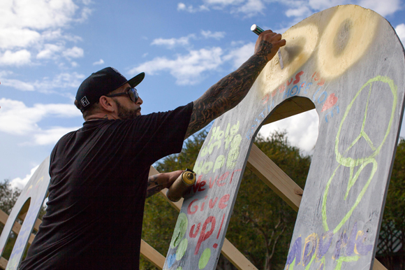 Salvatore Nastasia a graffiti artist from Fort Pierce adds to the Color St. Pete art installation.