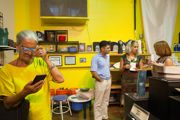 Paola Nesmith, left, visits art studios during the Second Saturday Art Walk at the new Arts XChange.