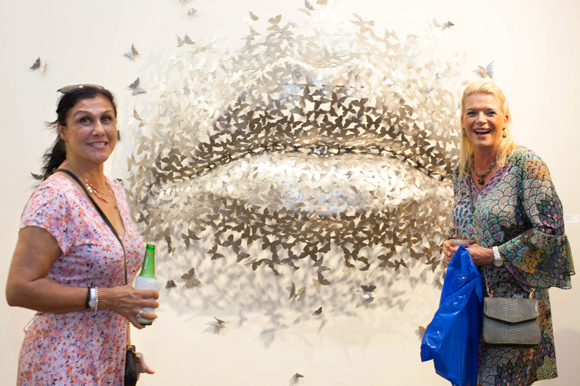 Saba Attari, left, and Kim Magnuson view 'Butterfly Kiss' by local and international sculptor Mark A