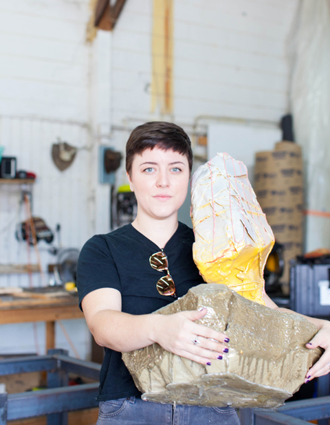Jenn Ryann Miller, a mixed media painter and sculptor, at her shared studio space.