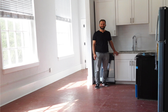 Michael Mincberg, president of Sight Real Estate, in a new kitchen at Euclid School apartments.