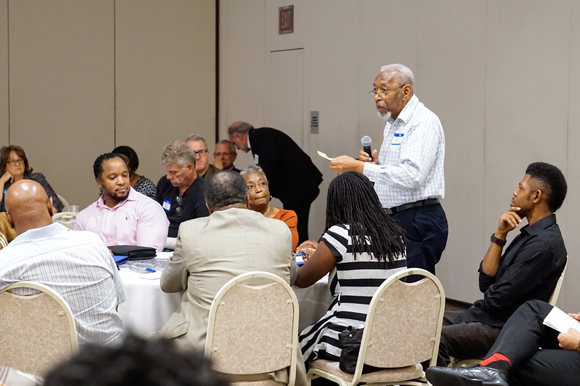 Ralph Scott, a West Tampa resident, presents his group's ideas during the meeting.