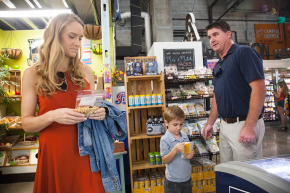 Lauren, Hudson, and Bryan Durkin pick up a popsicle at Duckweed Urban Market in downtown Tampa.