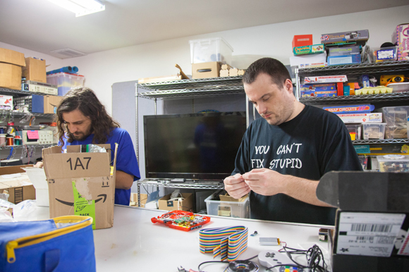 Kyle Parker and Caleb Paine work on their Game Boy Zero project at Tampa Hackerspace.