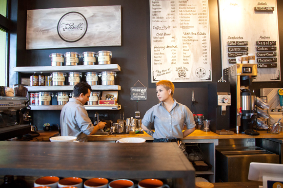 Esteban Cristancho, left, and Izzy Honda serve up hot drinks at Blind Tiger.