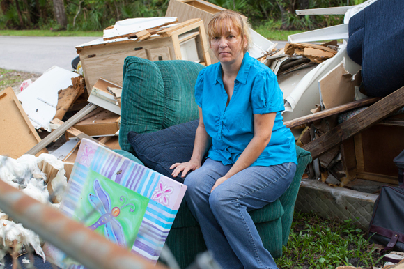 Mary Parker sits amongst items from her home that she lost during the storm surge in Crystal River from Hurricane Hermine.