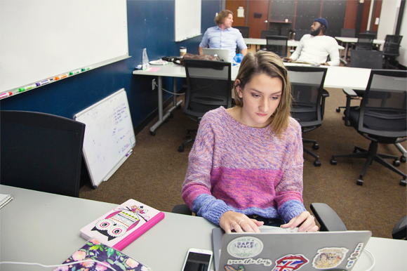 Emma Wolgast, a social media intern at Tampa Bay Wave, in the company's co-working space.