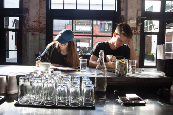 A duo studies and reads at Union Coffee and Tea in Armature Works.