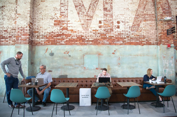 A co-working space on opening day inside Armature Works.