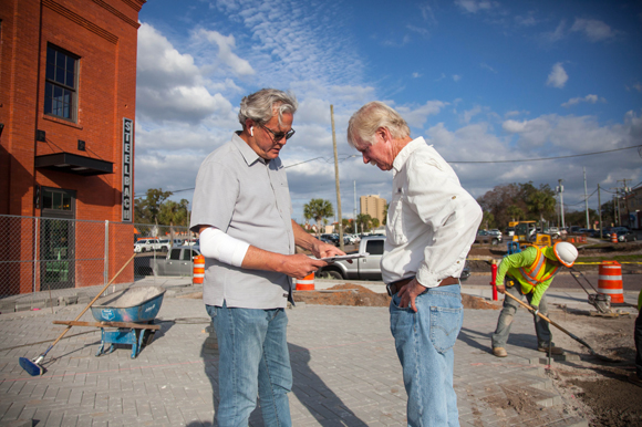 Adam Harden, co-owner of Armature Works, talks with Craig Hixon, a contractor at the new patio space.