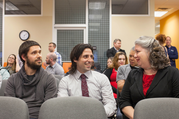 Michael Mattingly, left, Luis Orozco, and Giulia mingle at Launchcode's Tech Industry Networking Event.
