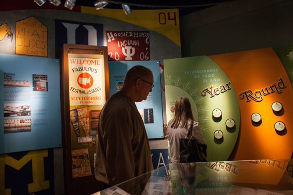 Zach Estrin of Venice, Fla., passes through an exhibit at the Tampa Bay History Center.