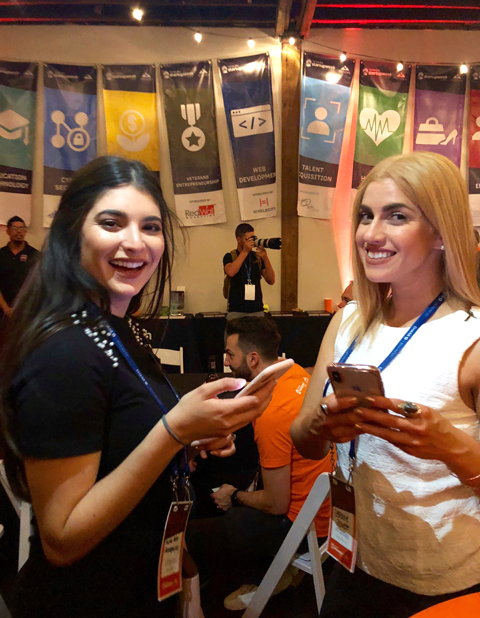 Alessa Solien (left) and panelist Stefanie Jewett exchange Instagram handles at the TBSW18 kickoff party.