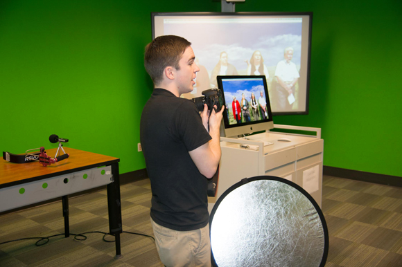 A student at the USF Library Digital Media Commons conducts a presentation.