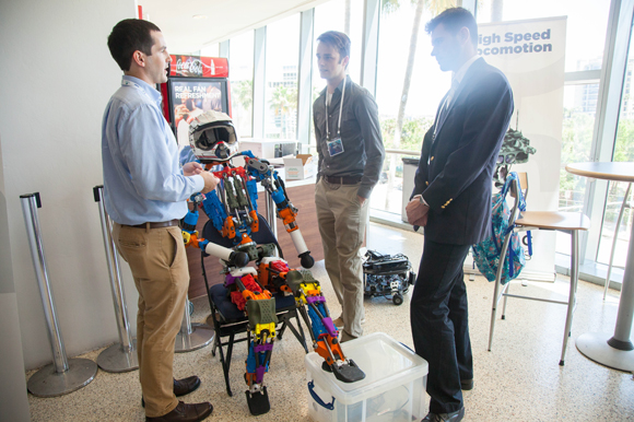 Dr. Robert Griffin, left, of IHMC Robotics talks with Johnny Coutant, and Christopher Eifler about humanoid robot Nadia made to be a disaster responder, and fire fighter.