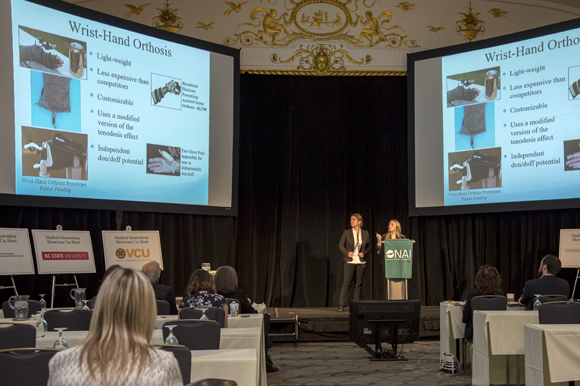 (L-R) Kalyn Kearney and Amber Gatto give a presentation on Powered Wrist-Hand Orthosis for Individuals with Spinal Cord Injury.