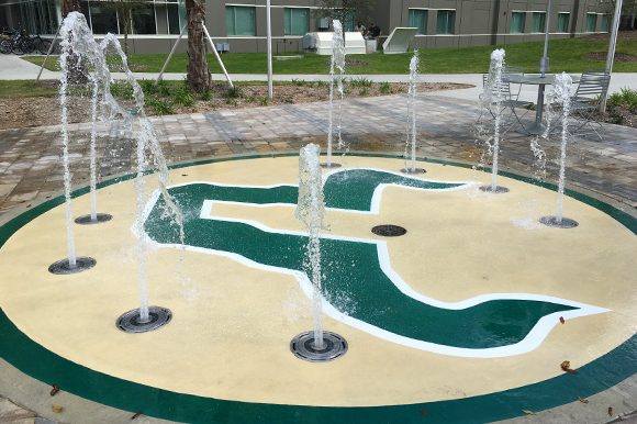 Outdoor gathering spaces include a new splash pad.
