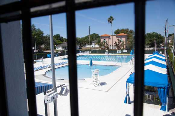 Original windows from 1941 look out over the pool at the JCC in West Tampa.
