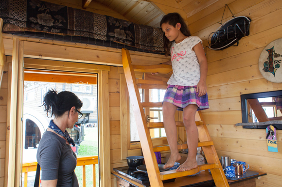 Erika Greco, and her daughter Nicole, 9, look through a log cabin built by Unforgettable Tiny House.