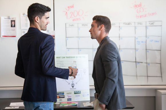 (L-R) Hayden Stokes of Tradebank of Tampa Bay talks with Djimo Serodio of Just Grow at the 2018 New Venture Expo at the University of Tampa.