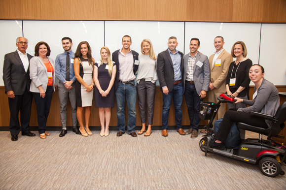 New Venture Expo student category first, second, and third place winners stand with event sponsors.
