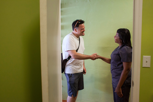 Eric Shippie greets Dr. Natalie Ellis, a licensed medical marijuana doctor, outside her office.