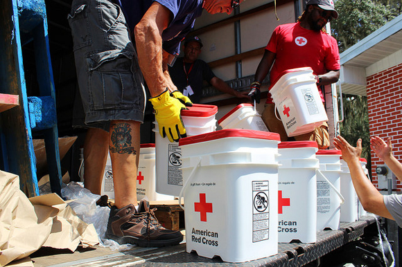 American Red Cross volunteers distribute limited supplies as Hurricane Irma approaches in 2017.