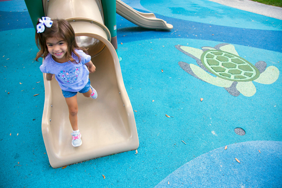 Maite Castillo, 3, plays at Macfarlane Park in West Tampa, named for Hugh Macfarlane who donated 40 acres for the creation of the park in 1908.