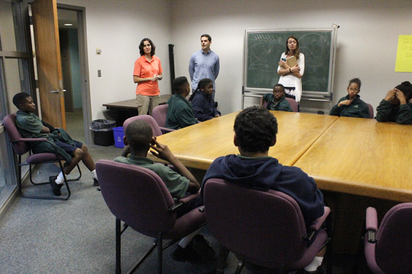 (L-R) Kelly Quinn, Bernardo Motta, Laura Manke, and Academy Prep students prepare to visit the USF College of Marine Sciences lab.