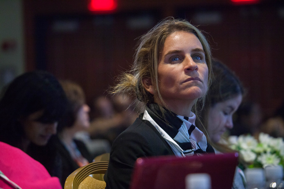 A woman looks on during the talk on translational research - building the gap from campus to community.