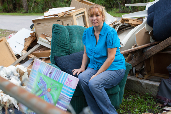 Mary Parker, a storm surge victim from Hurricane Hermine, sits amongst wreckage from her home in Crystal River.