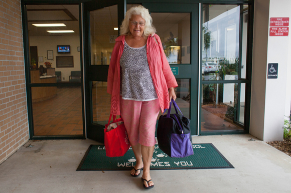 Daina Shukis leaves a Lecanto hurricane shelter after evacuating during Hurricane Matthew in 2016.