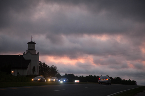 Cars pass by a Lecanto church the night before Hurricane Matthew made landfall in Florida in 2016.