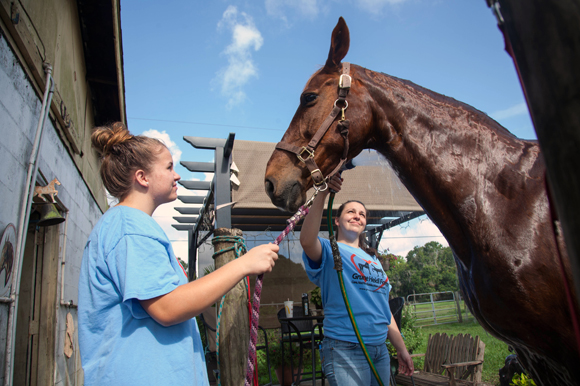 Hannah Hultgren and Bridget Bosch care for Shade, who was rescued at a Pennsylvania auction.