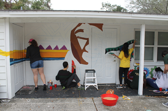 Volunteers work to improve the neighborhood at this year's Paint the Town event.