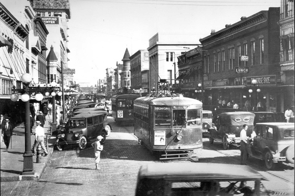 "A bustling Franklin Street in 1925. Two streetcars are seen operating together, known as a ""double header""."
