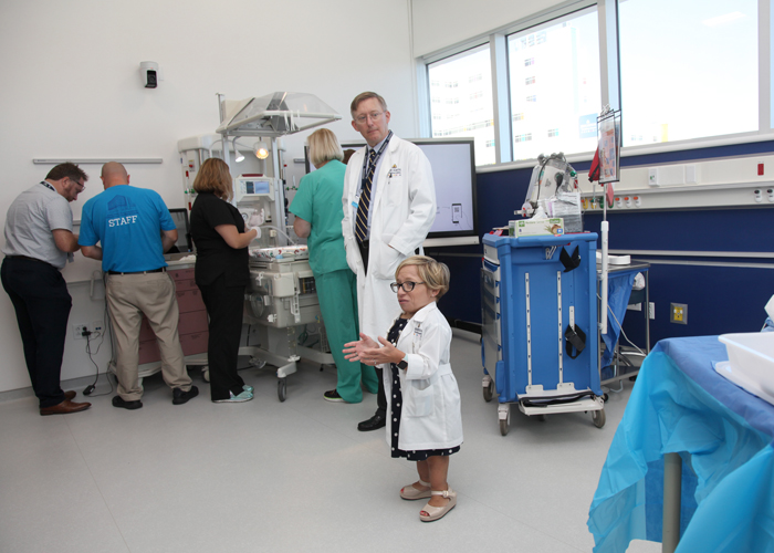 Dr., Paul Danielson, chief, div., of pediatric surgery, and Dr., Jennifer Arnold, medical director of the Simulation Center talk to media during the grand opening.