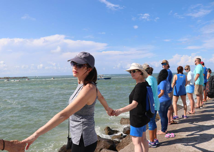 Hands Across the Sand in John's Pass, an area vulnerable to impacts from climate change.