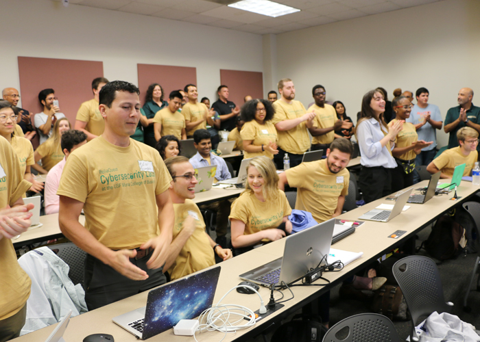 Students show their specialty T-shirts Friday on their first of class.