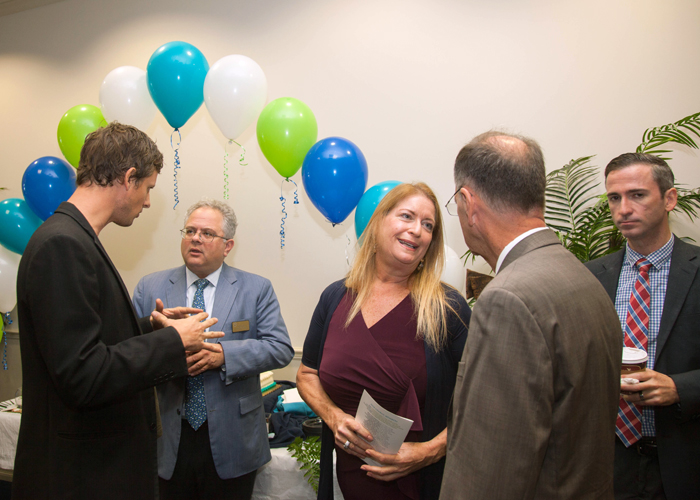 (L-R) David McDougal, Tampa City Councilman Harry Cohen, Susan Glickman, and Ian Whitney with the City of Tampa mingle at the event.