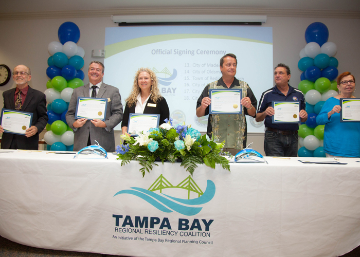 City officials from Clearwater, Dunedin, Gulfport, Indian Rocks Beach, Largo, and Indian Shores sign the official documents to create a more resilient area in the face of climate change.