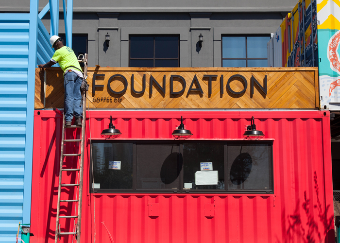 Foundation Coffee housed inside a storage pod gets finishing touches at Sparkman Wharf.