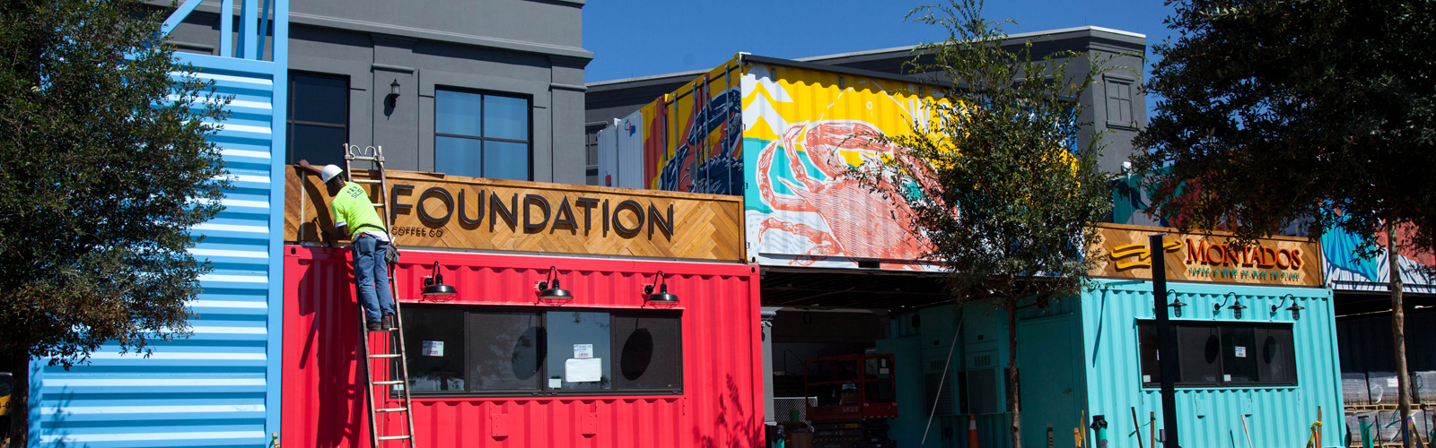 Restaurants inside eclectic shipping containers at Sparkman Wharf in the Channelside District.