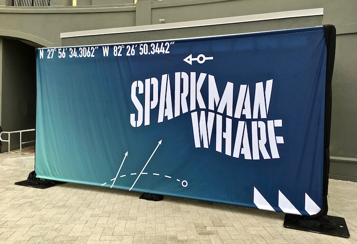Signage announcing opening of Sparkman Wharf.