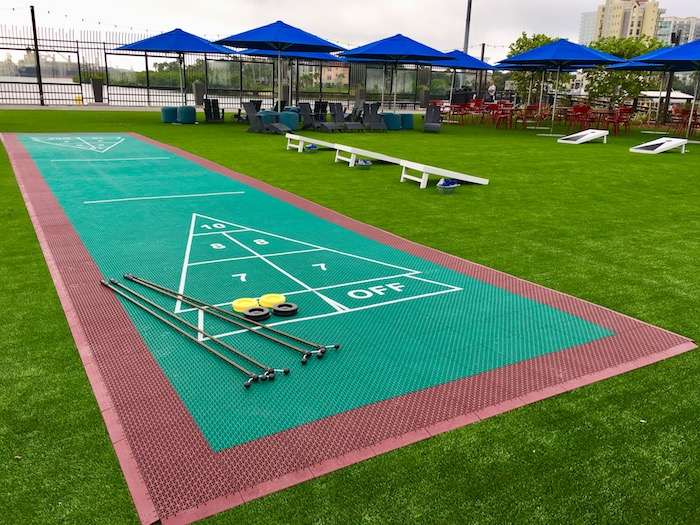 Outdoor shuffleboard and cornhole boards are part of the outdoor entertainment at Sparkman Wharf.