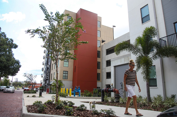 A Pearl resident walks past the newly designed wrap parking structure.