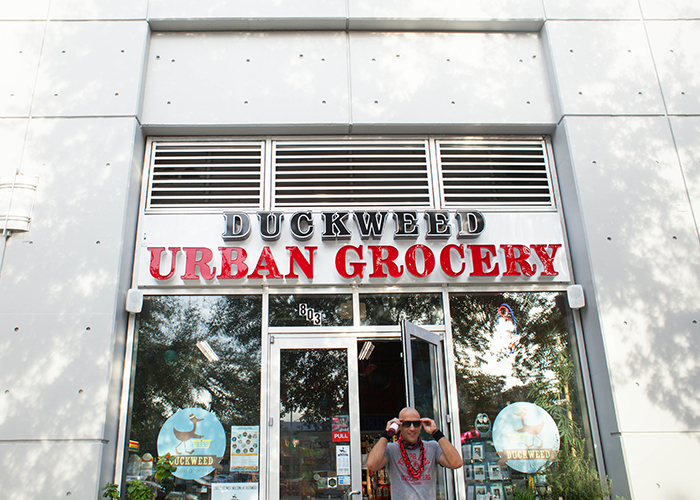 Brian Edwards of downtown Tampa exits Duckweed Urban Grocery, winner of the 2018 Marketplace Award.