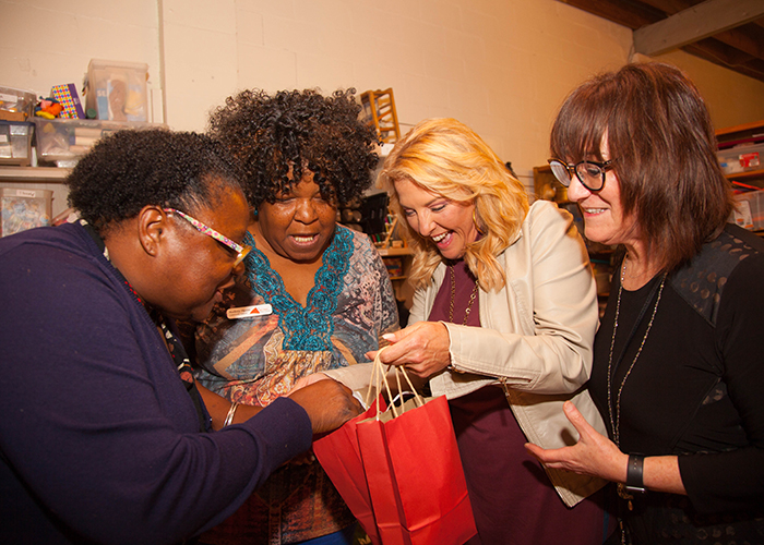Mozella Callaway, left, Audrey Myers, Suzanne Runyan, and Robyn Murphy mingle and shop at the Christmas party.