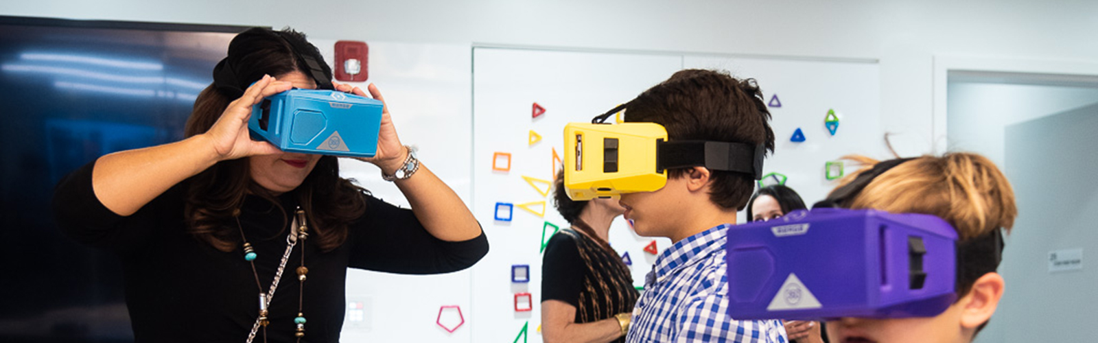 Students experiment with virtual reality goggles.